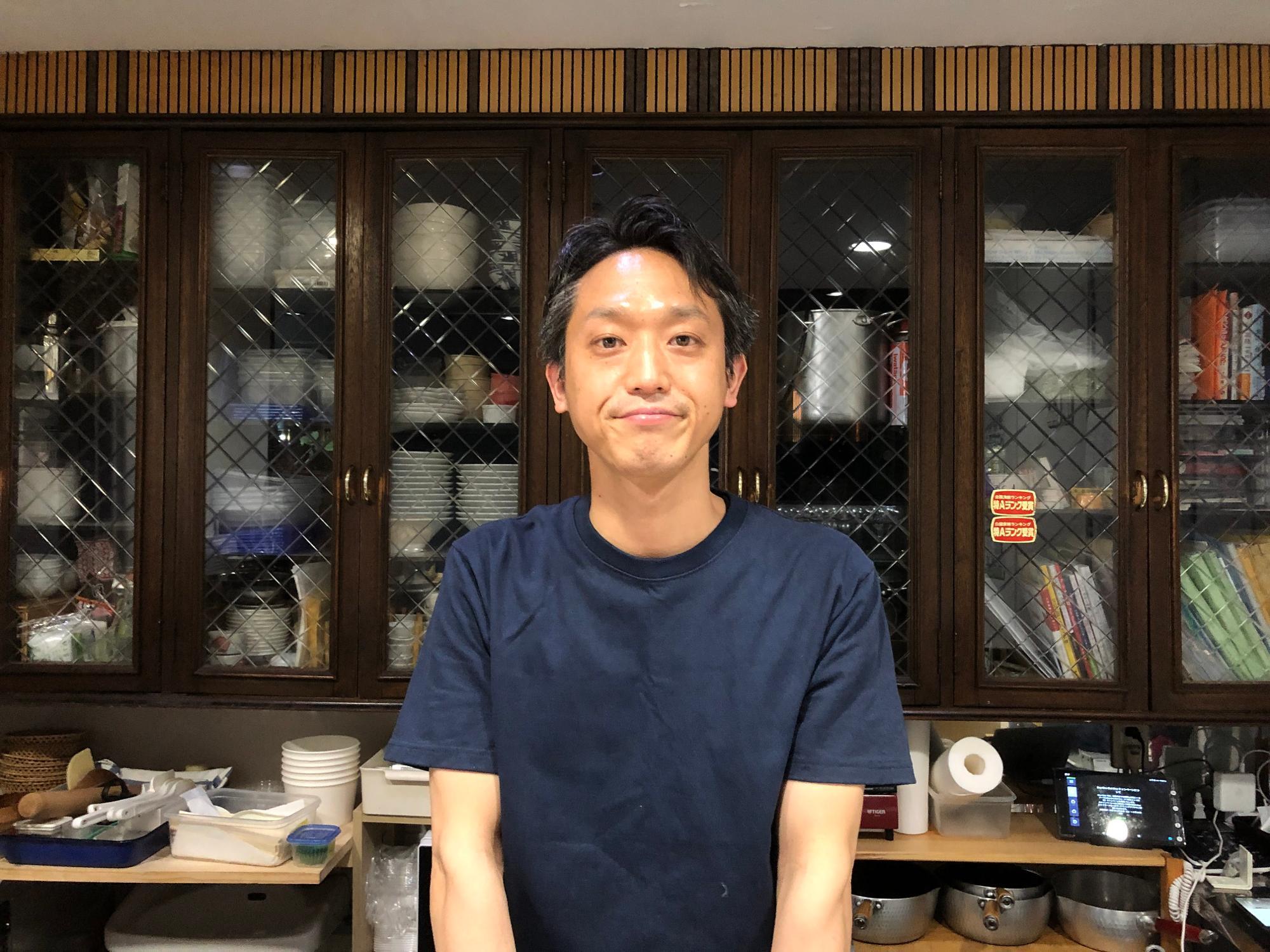 「粥や佐藤」店主の佐藤恭史さん